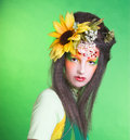 Fairy young woman in artistic image and with flowers in her hair Royalty Free Stock Photos