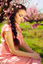 Fairy young woman sitting in blossomy garden Royalty Free Stock Photo