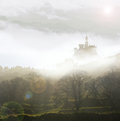 Fairytale castle in mist Royalty Free Stock Photo