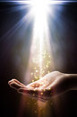 Faith falls on your hand rood light Royalty Free Stock Images