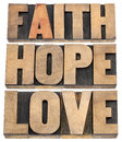 Faith hope and love typography a collage of isolated words in vintage letterpress wood type Stock Image