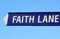 Faith lane text on road sign against blue sky background concept photo of love hope religion spiritual freedom worship help Stock Images