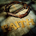 Faith word and the jesus christ crown of thorns and a nail in the holy cross Royalty Free Stock Images