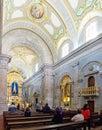 Faithful praying in the interior of the Sanctuary of Sao Bento da Porta Aberta. Royalty Free Stock Photo
