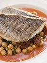 Faixas da brema de mar com salsicha do chorizo Foto de Stock Royalty Free