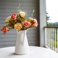 Fake colorful rose flower in white metal pitcher, The fabric flo Royalty Free Stock Photo