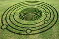 Fake crop circle in the meadow concentric circles and spiral to make a Royalty Free Stock Photo