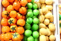 Fake fruits and fruits on shelves Royalty Free Stock Photography