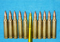 Fake News Invasion Concept. Cartridge 5 56 Mm Caliber With Pen as a Concept of Propaganda in Royalty Free Stock Photo
