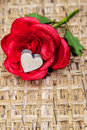Fake rose wooden heart satin red with a inside Stock Images