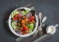 Falafel and fresh vegetables salad on dark background, top view. Vegetarian, diet food Royalty Free Stock Photo