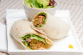 Falafel pita bread roll wrap sandwich traditional arab middle east food Stock Photos