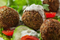 Falafel on salad leaves with tomatoes cucumber and pepper Stock Images