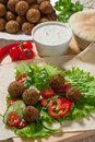 Falafel on salad leaves with tomatoes cucumber and pepper Stock Photos
