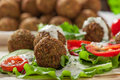 Falafel on salad leaves with tomatoes cucumber and pepper Stock Image