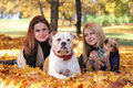 Fall and animals cute girls walking with dogs Royalty Free Stock Photos