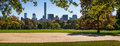 Fall in Central Park. Great Lawn, Midtown skyscrapers, New York Royalty Free Stock Photo