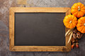 Fall chalkboard copy space with pumpkins Royalty Free Stock Photo