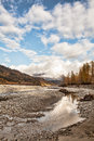 Fall on the chilkat river near haines alaska with interesting clouds Stock Photo