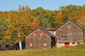 Fall colors on hillside with old barn Royalty Free Stock Photo