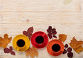 Fall concept. Cups of coffee and autumn leaves on a light wooden
