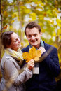 Fall - Cute young couple holding maple leaf Royalty Free Stock Images