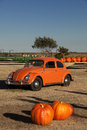 Fall harvest pumpkins for sale thanksgiving of at a roadside farm stand with orange car Royalty Free Stock Photography