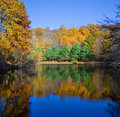 Fall lake stunning new england in with blue sky Royalty Free Stock Photo