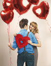 Fall in love among lots of balloons heart Stock Photo