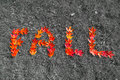 Fall red leaves that have fallen to the ground spelling out the word with a color splash effect Stock Photos