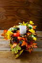 Fall table centerpiece with candle and silk maple leaves, vertic Royalty Free Stock Photo