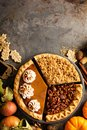Fall traditional pies pumpkin, pecan and apple crumble Royalty Free Stock Photo