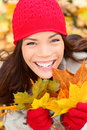 Fall woman holding autumn leaves Stock Photography