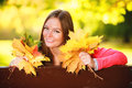 Fall. woman holding autumnal leaves in park Stock Photos