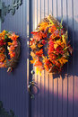 Fall wreaths on door Royalty Free Stock Photo