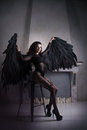 Fallen black angel with wings. Sexual woman Royalty Free Stock Photo