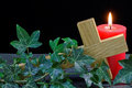 Fallen cross and candle on slate with ivy holy symbols for christian celebrations Stock Photo