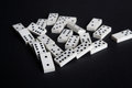 Fallen dominoes domino effect lose fail concept black background Royalty Free Stock Photo