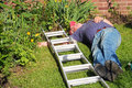 Fallen man from ladder unconcious an elderly lying on the ground after having fell a Royalty Free Stock Photo