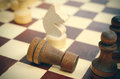 Fallen rook on background of horse black white defeated chess concept selective focus close up view vintage toning Stock Photography