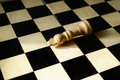 Fallen white wooden king empty chess board Royalty Free Stock Photos