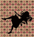 Falling alice silhouette on wonderland play card background Royalty Free Stock Image