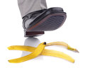 Falling on a banana skin businessman foot about to slip and fall Stock Photo