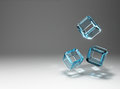 The falling cubes of glass. Stock Photos