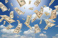 Falling dollars (sunny sky background) Royalty Free Stock Photos