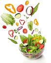 Falling fresh vegetables healthy salad isolated Royalty Free Stock Photos