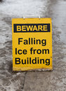 Before falling ice sign a warning people to watch for Stock Images