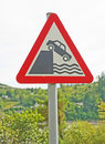 Falling off a cliff: danger sign. Royalty Free Stock Image