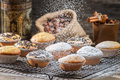 Falling powder sugar on vanilla muffins old wooden table Royalty Free Stock Photo