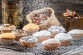 Falling powder sugar on vanilla muffins old wooden table Stock Image